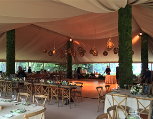 Wedding Reception Area Using Yazoo Tubes to Cover Up Tent Poles